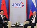 China, Russia Sound Alarm on World Economy at APEC Summit